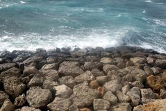 Landscape with seaea waves breaking of the big coastal stones. Landscape with sea waves breaking of the big coastal stones on sunny summer day Stock Photos