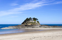 Landscape, seascape with beach and a house on top of a rock. Royalty Free Stock Photos