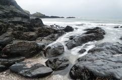 Landscape seascape of jagged and rugged rocks on coastline with Stock Photography