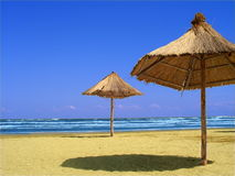 Landscape at the seaside. With two parasols Royalty Free Stock Image