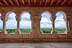 Landscape seen through romanesque church archs Stock Images