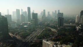 Landscape of Semanggi bridge interchange and skyscrapers. JAKARTA, Indonesia. September 14, 2017: Aerial footage of Jakarta skyscrapers around Semanggi stock video