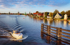 Landscape with ship and watermills in Netherlands Royalty Free Stock Image