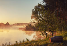 Landscape. shore of river, lake in the morning mist. late fall. Royalty Free Stock Photos