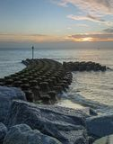 Sea defences at Ipswich at sunrise. A landscape shot of concrete sea defences at the coast off Ipswich during sunrise Royalty Free Stock Photography