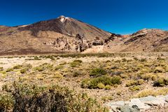 Pico de teide volcano. Landscape shot of the pico de teide volcano with some dry bushes in the foreground stock images