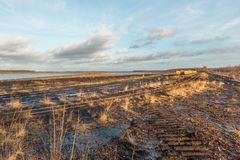Landscape shot with tracks and points system of a Moor train. Clouds and mud Stock Images