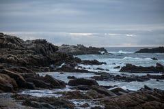 Landscape shot of waves hitting rocky seashore. On coastline of South Africa royalty free stock images
