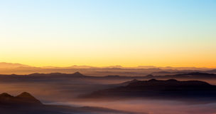 Landscape showing a misty. Showing a misty landscape at sunset Royalty Free Stock Photos