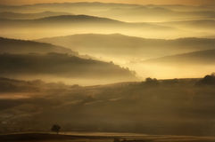 Landscape showing a misty morning at sunrise Royalty Free Stock Image