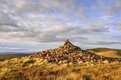 Moorland Hill Landscape of West Central Scotland. Landscape, showing stone cairn on scenic moorland hill of north Ayrshire, west central Scotland stock photos