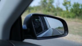 Landscape in the side view mirror of a car, on road countryside. Landscape in the side view mirror of a car, on road countryside stock video