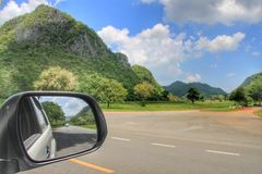 Landscape in the sideview mirror Stock Images