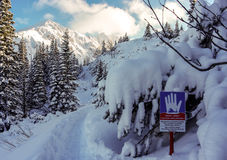 Landscape with a sign warning of the danger of avalanches. Tatry Royalty Free Stock Photography
