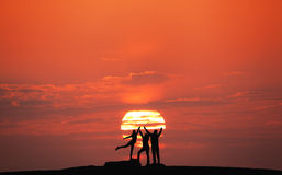 Landscape with silhouette of a happy family at sunset Royalty Free Stock Photos