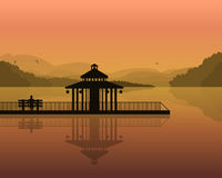 Landscape - silhouette of a man on a bench, and house on the background of the mountains, the sky with reflection in water. Vector Royalty Free Stock Images
