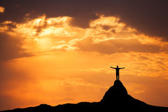 Landscape with silhouette of a man on the mountain peak Stock Photo