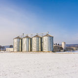 Landscape with silo and snow white Stock Images