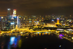 Landscape of the Singapore financial district and business building. In evening lights from sands SkyPark observation deck royalty free stock photography