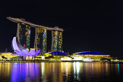 Landscape of Singapore Marina Bay hotel and art science museum. Landscape of the Singapore Marina Bay hotel and art science museum at night Stock Photo