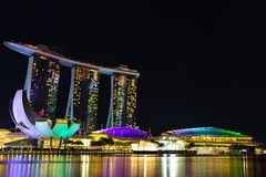 Landscape of the Singapore Marina Bay hotel, bridge, museum and. Financial district at night Stock Photography