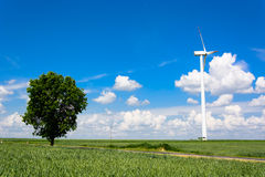 Landscape with single wind turbine Stock Images