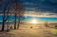 Landscape sketch of a winter`s evening, overlooking the lake. Landscape with a beautiful sunset on a winter evening royalty free stock image