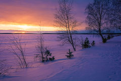 Landscape sketch of a winter`s evening, overlooking the lake. Landscape with a beautiful sunset on a winter evening Stock Photos