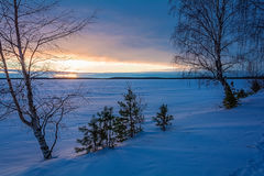 Landscape sketch of a winter`s evening, overlooking the lake. Landscape with a beautiful sunset on a winter evening stock photo
