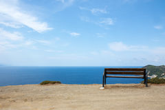 Landscape of Skiathos. Views of a bench with a girl and pines forest in Skiathos, Greece royalty free stock photos