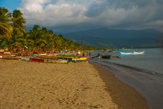 Landscape sky with clouds, volcanic sand on the beach. Pandan, Panay, Philippines. Royalty Free Stock Photography