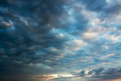 Landscape with sky and  dark storm clouds Stock Photos