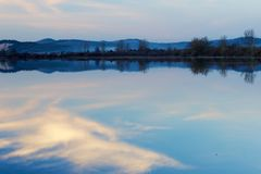 Sky mirrored in a lake Royalty Free Stock Images