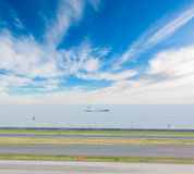Landscape of sky and sea with runway in airport. Landscape of bright sky and sea with runway in airport Stock Images