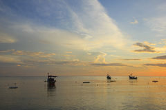 Landscape of sky and sea which has small fishing boat at dawn ; southern of Thailand Stock Photo