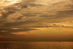 Landscape of sky and sea which has small fishing boat in morning ; Songkhla province Thailand Stock Photos