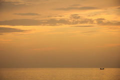 Landscape of sky and sea which has small fishing boat in morning ; Songkhla province Thailand Stock Photography