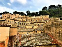 Landscape, sky, trees, medieval houses and roofs in Tossa de Mar, Spain royalty free stock image