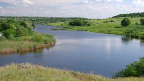 Landscape with small river at windy summer day. Ukrainian country landscape with small river Sura at windy summer day stock video