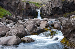 Landscape with small waterfall, river with clear water and rocks, Iceland Royalty Free Stock Photos