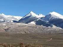 Snow capped peaks stock image