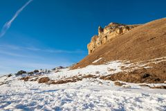 The landscape of snow-covered Caucasian rocks on the Gumbashi Pass. A huge sharp array of rocks at an altitude of 2100 meters above sea level with a snow Royalty Free Stock Photo