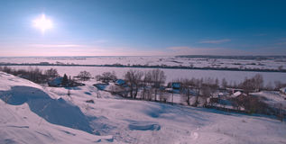 Landscape of a snow-covered hill and blue sky. Stock Image