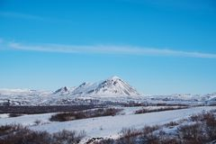 Landscape snow field with mountain and blue sky in winter Royalty Free Stock Images