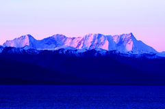 Landscape of snow mountains and blue lake royalty free stock images