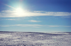 Landscape with snowed cultivated agricultural field in win Royalty Free Stock Images