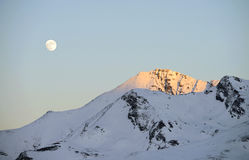Landscape of snowy mountains, with the moon Stock Image