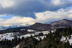 Landscape with snowy mountains under cloudy sky Royalty Free Stock Images