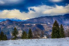 Landscape with snowy mountains under cloudy sky Stock Photos