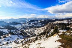Landscape with snowy mountains under cloudy sky. Romania Stock Photo
